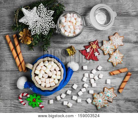 Christmas homemade gingerbread cookies hot drink chocolate marshmallow. Christmas snowflakes. Christmas drink hot cocoa chocolate in cup scarf. Sweets ingredients for hot chocolate.