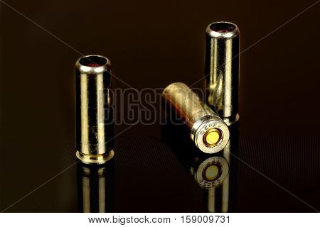 Cartridges for the traumatic gun close up on a black background.