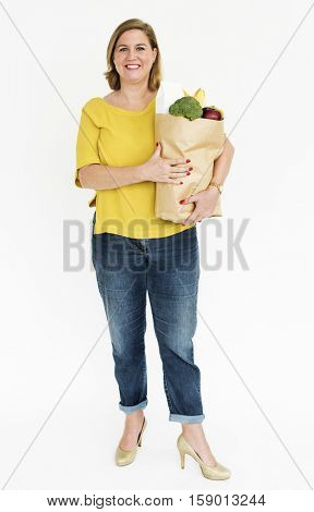 Woman carrying a bag of groceries