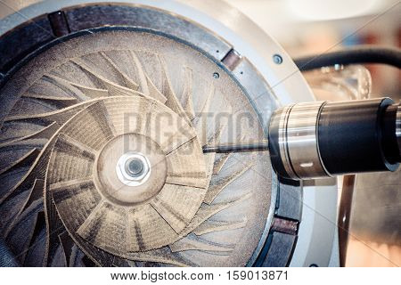 Five-axis machine for the processing of basic parts at high speeds during milling. The machine for the treatment of avia, air turbine closeup. Milling machine carves turbine blades close-up