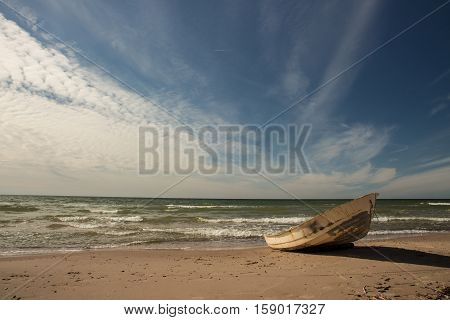 Stunning sky over a fishing boat on Baltic beach