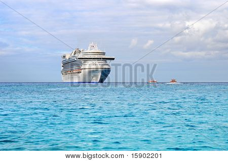 Passenger cruise ship in the Caribbean with tender boats