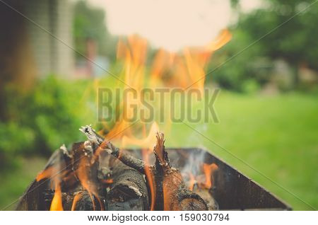 Burning wood in a brazier. Fire flames