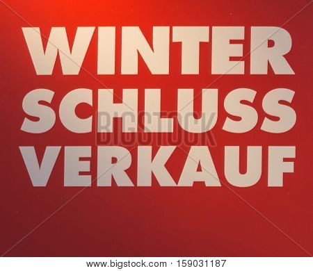 Label with inscription in German Winter clearance saleon red background.