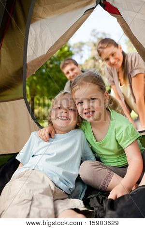 Happy family camping in the park