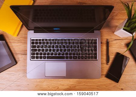 Laptop tablet computer and smartphone - mobile electronics on business office desktop top view