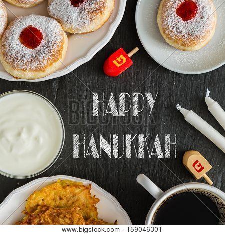 Symbols of Hanukkah celebration on wood background, copy space, top view