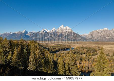 the scenic landscape of the tetons in fall from the snake river overlook