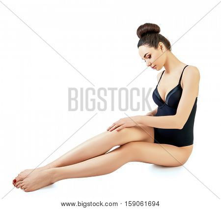 Portrait of beautiful woman, full length. Attractive girl with perfect body posing at studio over white background with copy space.