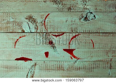 Red wine stains on colour wooden background