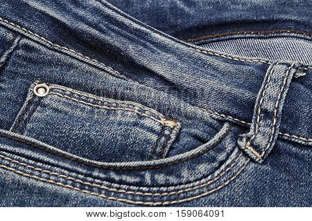 Fragment of blue jeans close up background