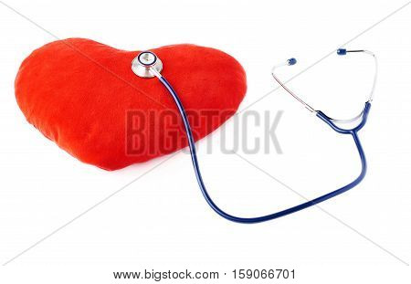 Close up view of blue stethoscope with toy plush heart over isolated white background