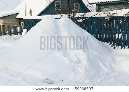 snow slide for small children in the village street in winter