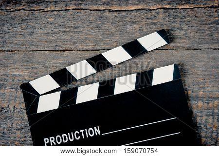 Film Slate lying on a wooden board