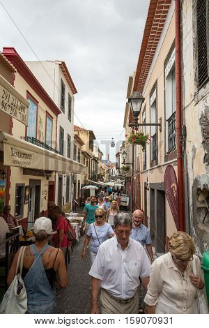 FUNCHAL, MADEIRA, PORTUGAL - SEPTEMBER  4, 2016: Santa Maria Street in Funchal town on Madeira Island. Portugal