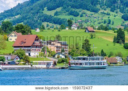 Small boat sailing on Lucerne lake, Switzerland.