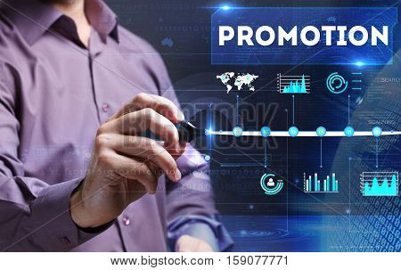Technology, Internet, Business And Marketing. Young Business Man Writing Word: Promotion