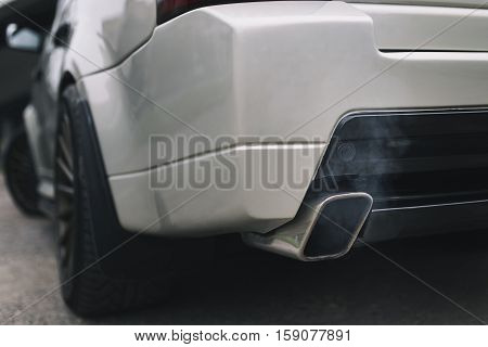 Exhaust car pipe smoked in air close up