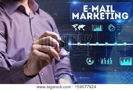 Technology, Internet, Business And Marketing. Young Business Man Writing Word: E-mail Marketing