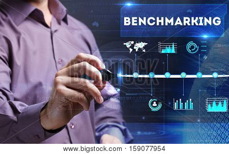 Technology, Internet, Business And Marketing. Young Business Man Writing Word: Benchmarking