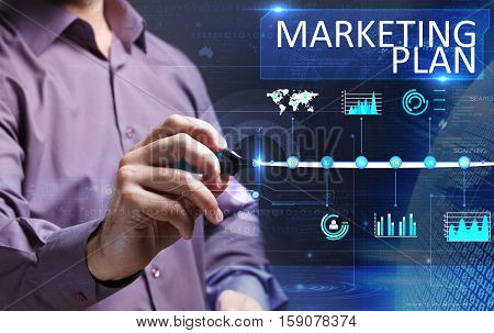 Technology, Internet, Business And Marketing. Young Business Man Writing Word: Marketing Plan