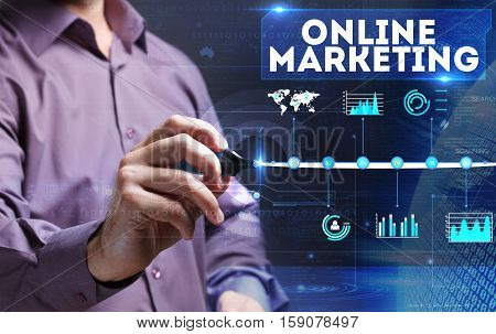 Technology, Internet, Business And Marketing. Young Business Man Writing Word: Online Marketing
