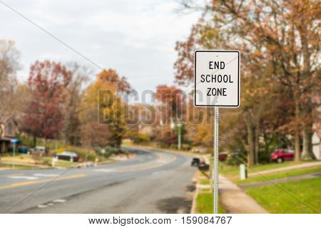 Public End School Zone sign on road