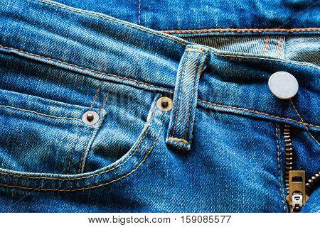 background  of pocket of blue jeans close up