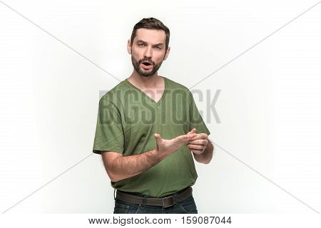 Man is looking pouter with an imaginary object in his hands. Over white background