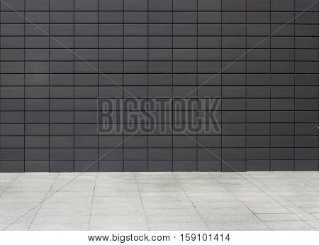 urban background business building texture with dark metallic plates wall and white sidewalk empty setting no people