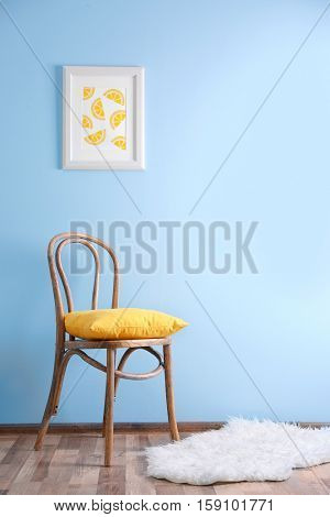Simple interior with stool and painting on blue wall background