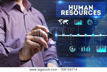 Technology, Internet, Business And Marketing. Young Business Man Writing Word: Human Resources