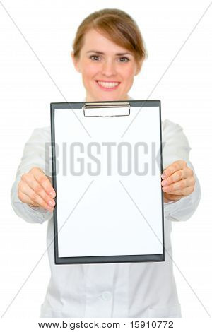 Smiling medical female doctor holding blank clipboard in hands isolated on white