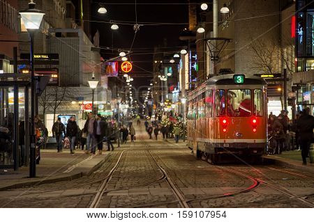 NORRKOPING, SWEDEN - DECEMBER 20, 2013: Christmas shoppers in the city center of  Norrkoping.  Norrkoping is a historic industrial town in Sweden