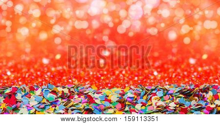 Colorful confetti against a glowing rite background