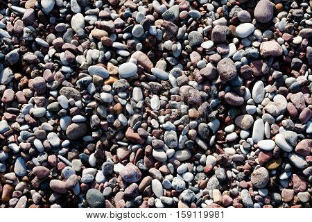 marine pebbles on the shore of the Baltic Sea, to grind with water in various sizes and colors, the oval and round, nature, natural,