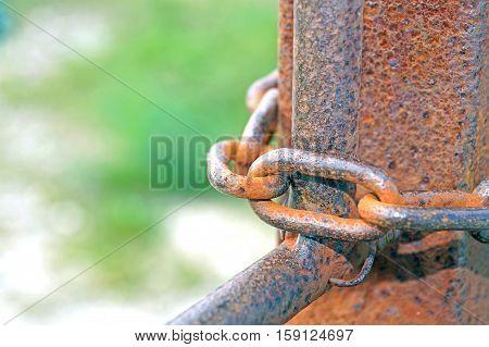 Metal chain on blurry grunge metal background