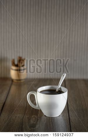 black coffee white cup on the wooden table