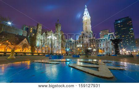 Philadelphia, April 2015, USA: Wide angle view of Philadelphia historic City center at night, one of the famous landmarks - building of Philadelphia City Hall, the seat of government for the city