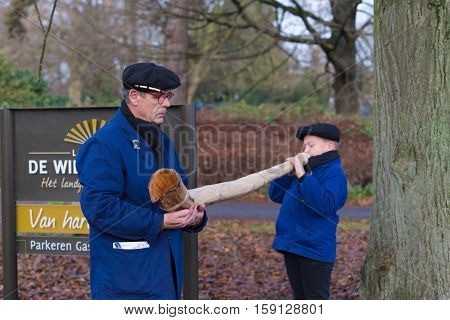 OLDENZAAL NETHERLANDS - NOVEMBER 27 2016: Unknown young boy blowing a so called