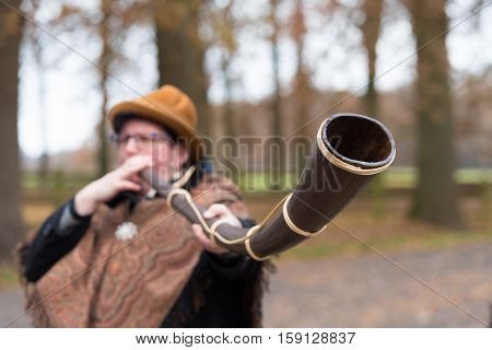 OLDENZAAL NETHERLANDS - NOVEMBER 27 2016: Unknown woman blowing a so called