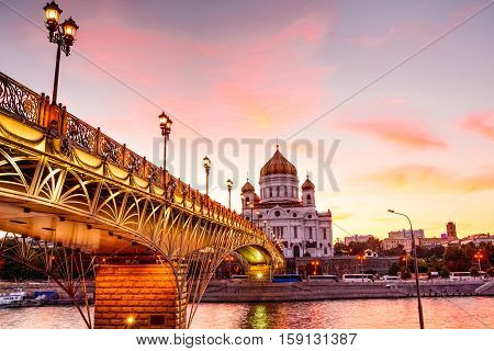 Christ the Savior Cathedral at sunset. Partiarshy footbridge with light golden hour