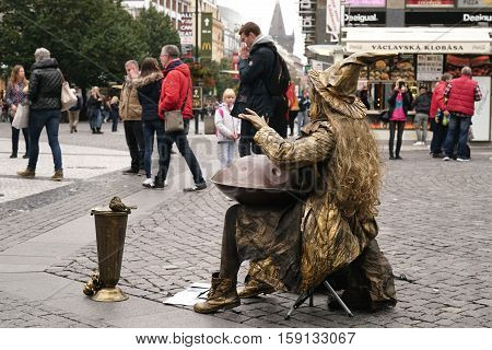 PRAGUE, CZECH REPUBLIK - OCTOBER 18, 2016: young street musician in the historic center of Prague entertains tourists. She plays on a Hang that was invented in 2000 by Felix Rohner and Sabina Schaerer from Switzerland