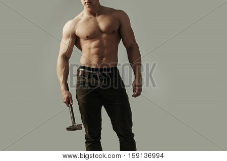 Sexy Muscular Man With Hammer
