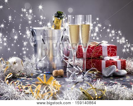 Two champagne glasses cooler and two red gift with white ribbon