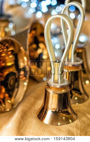 Set of gold handbells on table during concert. Christmas time