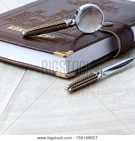 Stationery Magnifying Glass, Paper Knife And A Notebook