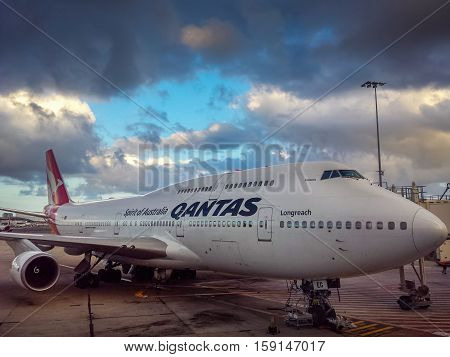 Sydney, Australia - Dec 22, 2015: A Qantas Jumbo 747-400 Longreach docked to the jetway at Sydney's Kingsford-Smith International Airport. Qantas is the flagship carrier airline of Australia.