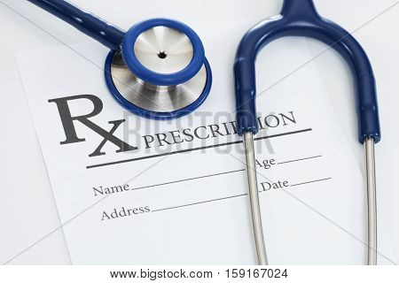 Medical Prescription Form With Stethoscope Over It