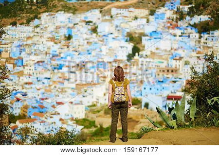 Tourist enjoying aerial view of of Chefchaouen Morocco small town in northwest Morocco known for its blue buildings